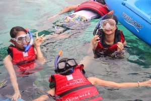 My friends spending time snorkeling.