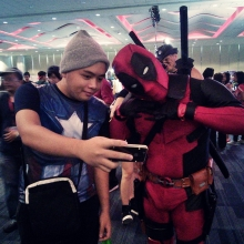Deadpool poses with fan.
